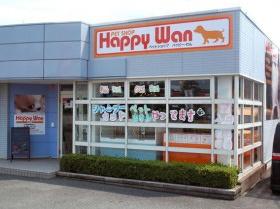 水色の外壁とガラスで囲まれた店舗